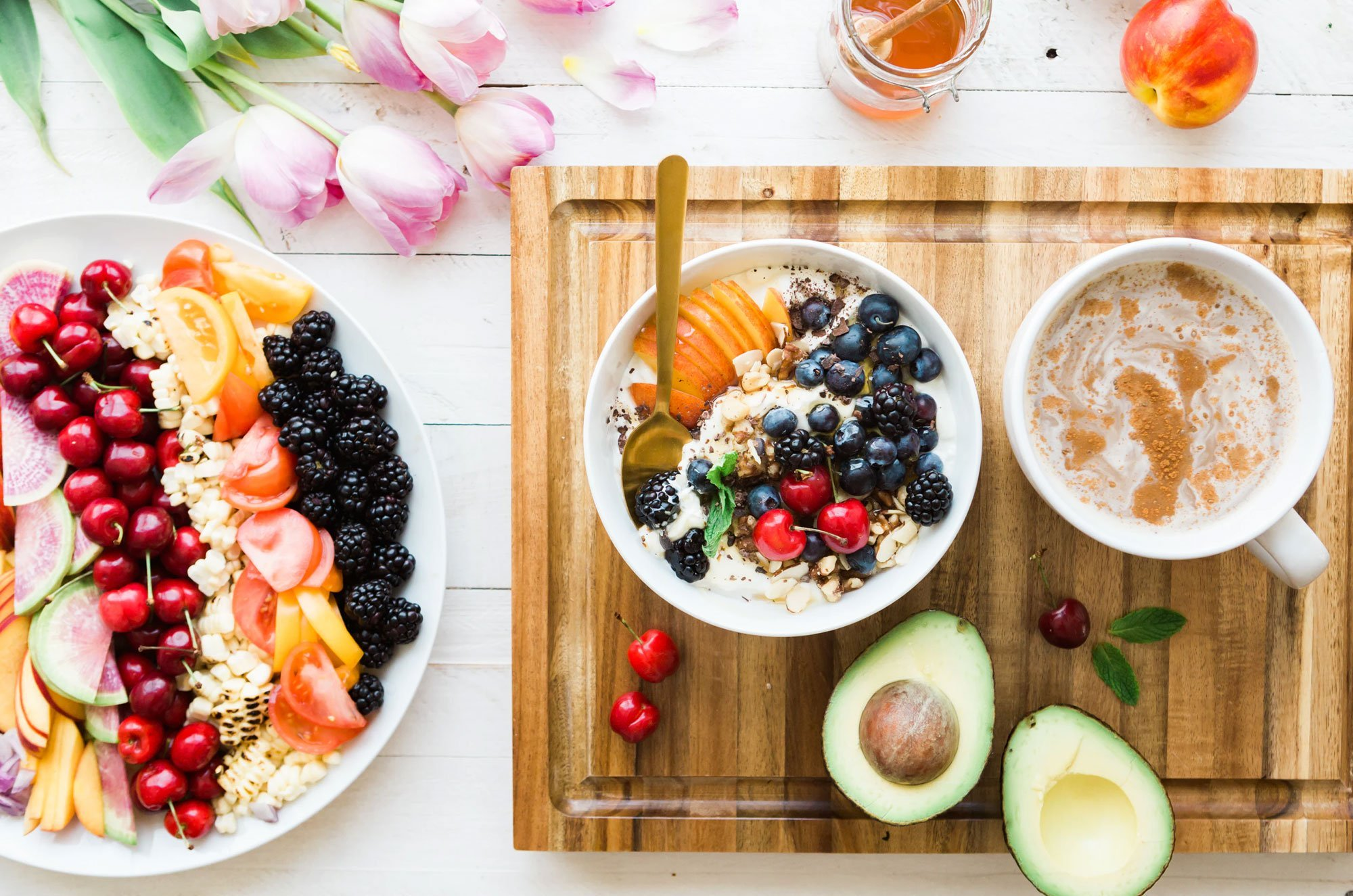 Breakfast cereal, fruit and flowers